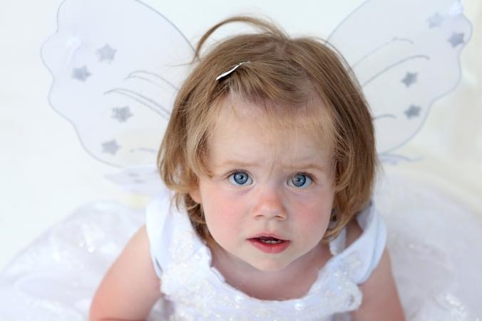 bigstock-little-girl-in-beautiful-dress-34574639