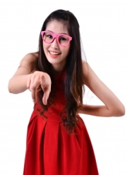 smiling asian pointing girl